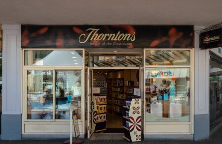 Swindon, United Kingdom - May 04 2019:   The Frontage of Thorntons Chocolate Store on the Parade