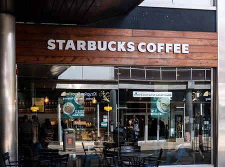 Swindon, United Kingdom - May 04 2019:   The Frontage of Starbucks Coffee Shop in Canal Walk Редакционное