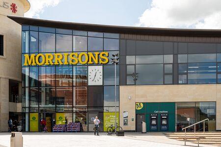 Swindon, United Kingdom - May 04 2019:   The entrance to Morrisons Supermarket at Regent Circus Редакционное
