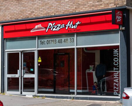 Swindon, United Kingdom - May 04 2019:   The entrance to Pizza Hut fast food delivery shop in Lincoln Street