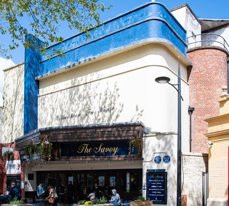 Swindon, United Kingdom - May 04 2019:   Frontage of the Savoy Weatherspoons pub, formerly a Cinema, on Regent Street