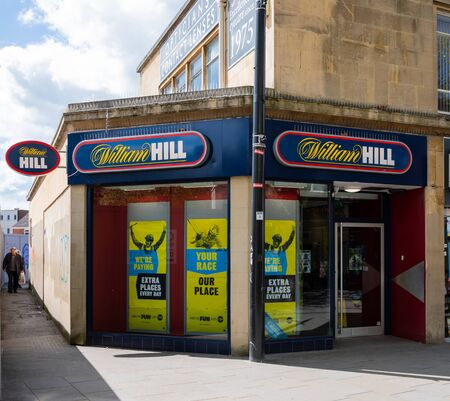 Swindon, United Kingdom - May 04 2019:   The entrance to William Hill Bookmakers on Temple Street