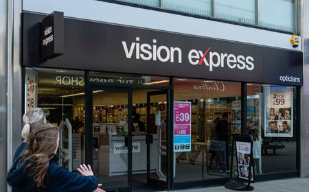 Swindon, United Kingdom - May 04 2019:   The Entrance to Vision Express opticians in Regent Street