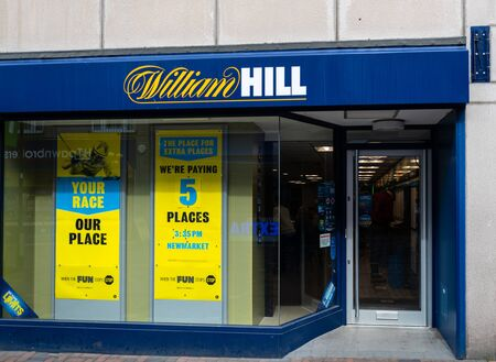Swindon, United Kingdom - May 04 2019:   The Frontage of William Hill Bookmakers on Regent Street Редакционное