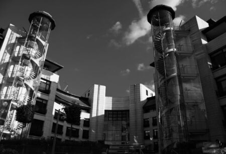 Reading, United Kingdom - May 24 2019:   Moody monochrome image of the rear of the Thames Water office on Vastern Road seen from the Thames Path