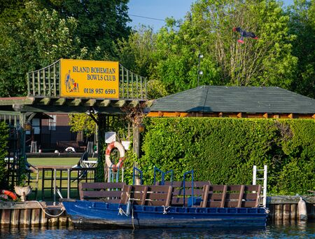 Reading, United Kingdom - May 24 2019:   The sign above the entrance to the Island Bohemian Bowls Club on a small island in the middle of the River Thames