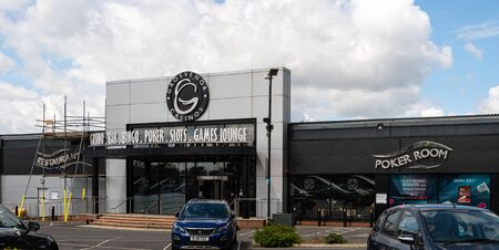 Reading, United Kingdom - May 27 2019:   The frontage and car park of Grosvenor Casino on Basingstoke Road