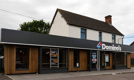 Thatcham, United Kingdom - May 27 2019:   The frontage of Dominos Pizza shop on London Road