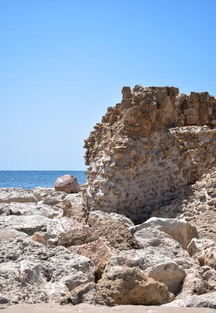 The remains of an ancient wall overlooks the Mediterranean sea in Cyprus