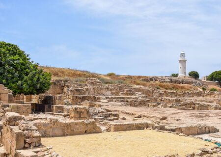 The lighthouse of Paphos looms above the skyline over loooking the Mediterranean Sea 版權商用圖片