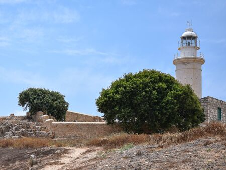 The lighthouse of Paphos looms above the skyline over loooking the Mediterranean Sea Archivio Fotografico