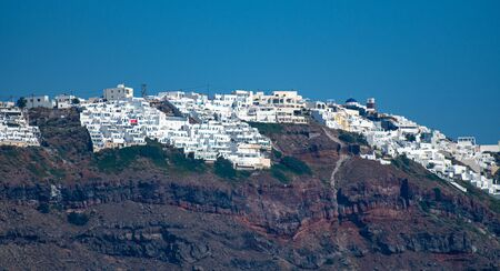 The whitewahsed buildings of the town of Finikia taken from the Aegean Sea