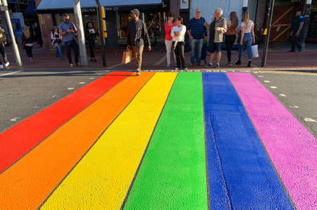 Reading, United Kingdom - August 30 2019:   Repainted with rainbow colours for the 2019 Reading Pride event, the Pelican crossign across Friar Street
