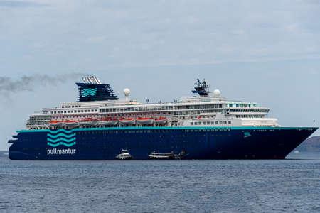 Fira, Greece - July 16 2019:   The Pullmantur Cruise liner Horizon anchored in the Aegean Sea off the coast of Santorini at Fira