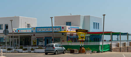 Megalochori, Greece - July 17 2019:   Playland childrens play centre with a Spongebob Squarepants statue outside along the Fira to Perissa road Editorial