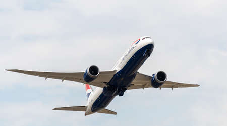 Heathrow, United Kingdom - August 03 2019:  British Airways Boeing 787-9 Dreamliner registration G-ZBKM,  flight number BA249 departs Heathrow airport en route to Rio De Janeiro seen from Myrtle Avenue Editorial