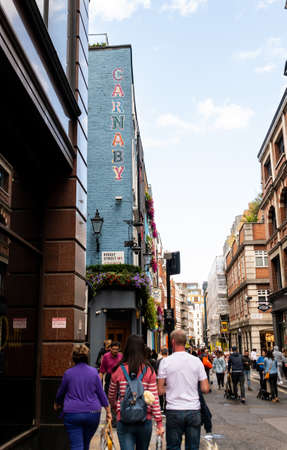 London, United Kingdom - August 18 2019:  Shoppers and tourists in the streets and shops of Carnaby Street market on Beak Street