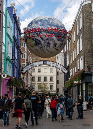 London, United Kingdom - August 18 2019:  Shoppers walk past shops bars and restaurants on the world famous Carnaby Street Editorial