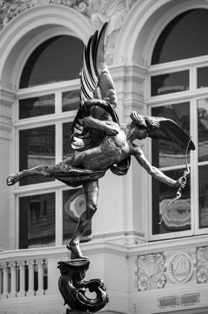 London, United Kingdom - August 18 2019:  The Shaftesbury Memorial Fountain statue of Anteros, often called Eros, by Alfred Gilbert, in the centre of Picadilly Circus Editorial