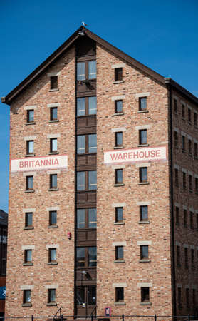 Gloucester, United Kingdom - September 08 2019:  The Britannia Warehouse, built in 1861 and now converted into flats, on Gloucester Dock road