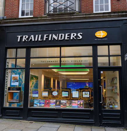 Guildford, United Kingdom - November 06 2019:  The frontage of Trailfinders Travel Agency on High St