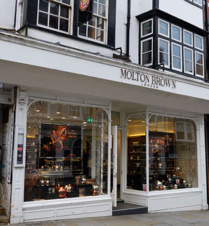 Guildford, United Kingdom - November 06 2019:  The frontage of the Moulton Brown store on High Street Editorial