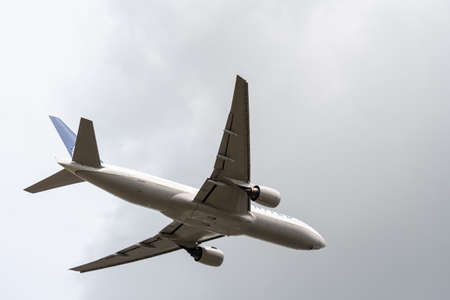 Heathrow, United Kingdom - August 03 2019:  United Airways Boeing 777-222 registration N206UA, flight number UA949 departs Heathrow airport en route to San Francisco seen from Myrtle Avenue Editorial