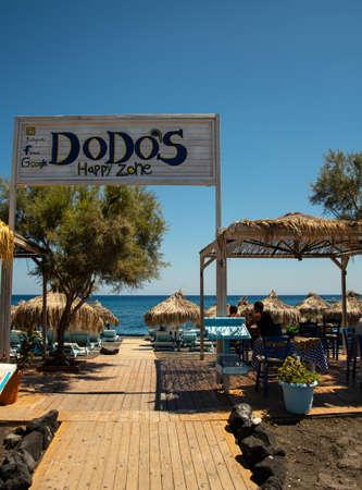 Perissa, Greece - July 18 2019:   The entrance to Dodo's Happy Zone beach bar and restaurant on Perissa Sea front