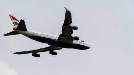 Heathrow, United Kingdom - August 03 2019:   British Airways Boeing 747-436 registration G-CIVY,  flight number BA217 departs Heathrow airport en route to Washington seen from Myrtle Avenue