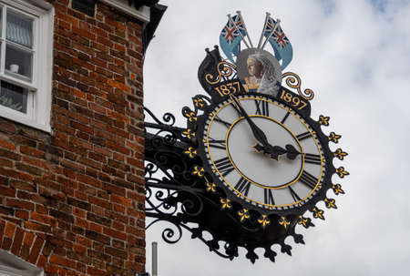 Wotton-Under-Edge, United Kingdom - September 07 2019: An ornate hanging clock celebrating Queen Victoria's Diamond Jubilee in 1897 on Market Street