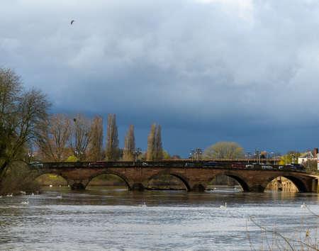 A shot of dark clouds looming up behind Worcester Bridge over the River Severn Reklamní fotografie