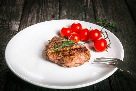 animal origin: steak and tomatoes on a plate