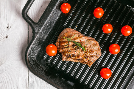 animal origin: steak and cherry tomatoes in a pan