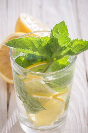 Soft drink with lemon, ice and mint