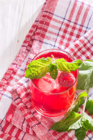 refreshing non-alcoholic soft drink with ice and mint