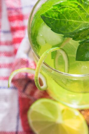 Soft drink with lime, ice and mint