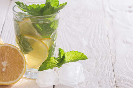 sourness: Soft drink with lemon, ice and mint