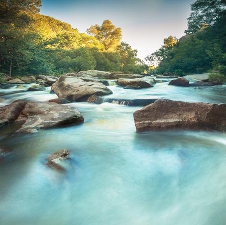 mountain river flowing between rocks Stock Photo