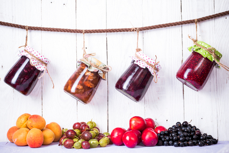 homemade jam in jar on wood background. healthy organic and vegan food Stock Photo