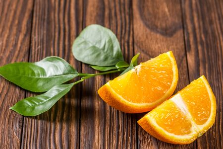 ascorbic acid: cut orange slices and orange tree branch Stock Photo
