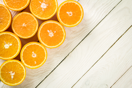 ascorbic acid: Fresh oranges on a white wooden table