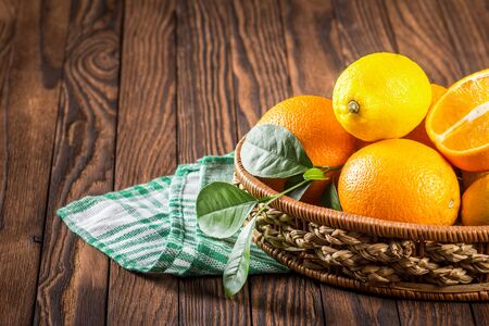 basket of fresh oranges on a wooden table