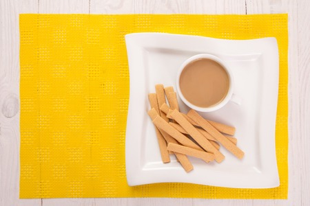 Cookies, a cup of coffee with milk on the table Stock Photo