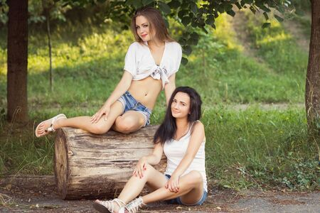 Happy smiling friends, having fun outdoors. Attractive young women in summer city, youth fashion
