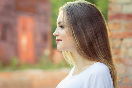 Portrait of a young sweet girl , face in profile, the concept of beauty and health