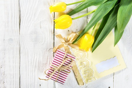 holland: Bouquet of beautiful tulips. Gift box on a white wooden background
