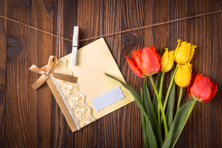holland: bouquet of tulips and a card on a rope with clothespin