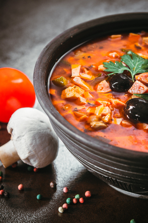 Traditional Russian soup solyanka closeup in a bowl on the table. Stock Photo