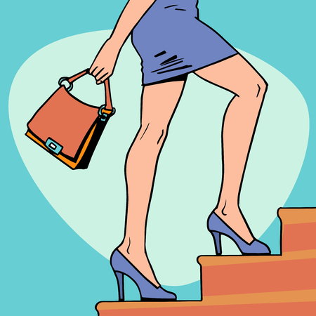 Beautiful girl goes up the stairs. Legs of a young woman. Business concept career. Fashion and beauty.