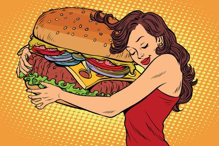 ハンバーガーを抱いて美しい若い女性